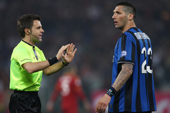 ROME - MAY 05: The referee Nicola Rizzoli (L) talks with Marco Materazzi of FC Internazionale Milano during the Tim Cup between FC Internazionale Milano and AS Roma at Stadio Olimpico on May 5, 2010 in Rome, Italy.  (Photo by Paolo Bruno/Getty Images)