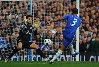 LONDON, ENGLAND - OCTOBER 03:  Ashley Cole of Chelsea shoots past Lukasz Fabianski of Arsenal but sees his 'goal' disallowed for offside during the Barclays Premier League match between Chelsea and Arsenal at Stamford Bridge on October 3, 2010 in London,