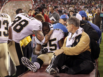SAN FRANCISCO - SEPTEMBER 20:  Reggie Bush #25 of the New Orleans Saints is consoled by Jeremy Shockey #88 before Bush leaves the field due to an injury during their game against the San Francisco 49ers at Candlestick Park on September 20, 2010 in San Fra