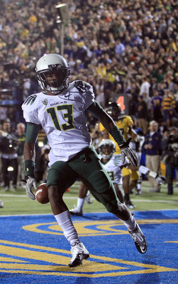 BERKELEY, CA - NOVEMBER 13:  Cliff Harris #13 of the Oregon Ducks returns a punt for a touchdown against the California Golden Bears  at California Memorial Stadium on November 13, 2010 in Berkeley, California.  (Photo by Ezra Shaw/Getty Images)
