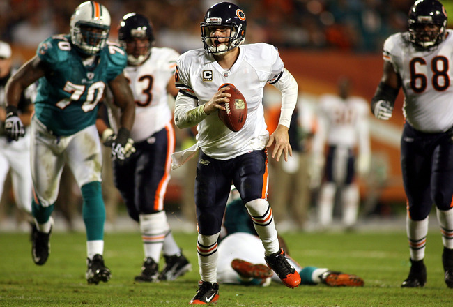 MIAMI - NOVEMBER 18:  Quarterback Jay Cutler #6 of the Chicago Bears scrambles against the Miami Dolphins at Sun Life Stadium on November 18, 2010 in Miami, Florida.  (Photo by Marc Serota/Getty Images)