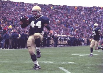 21 Oct 1995:  Fullback Marc Edwards of the Notre Dame Fighting Irish celebrates as he enters the end zone, scoring a touchdown, during the Fighting Irish's 38-10 victory over the USC Trojans at Notre Dame Stadium in South Bend, Indiana. Mandatory Credit: