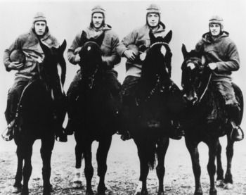 The Four Horsemen of Notre Dame, (L-R) quarterback Harry Stuhldreher, fullback Elmer Leyden, left halfback Jim Crowley, and right hafback Don Miller. George Strickler, Knute Rockne's student publicity aide posed the four players, dressed in their uniforms