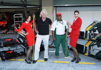 ABU DHABI, UNITED ARAB EMIRATES - NOVEMBER 13:  Sir Richard Branson of Virgin GP and Tony Fernandes of Lotus are seen in the paddock before qualifying for the Abu Dhabi Formula One Grand Prix at the Yas Marina Circuit on November 13, 2010 in Abu Dhabi, Un
