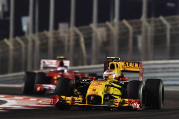 ABU DHABI, UNITED ARAB EMIRATES - NOVEMBER 14:  Vitaly Petrov of Russia and Renault leads from Fernando Alonso of Spain and Ferrari during the Abu Dhabi Formula One Grand Prix at the Yas Marina Circuit on November 14, 2010 in Abu Dhabi, United Arab Emirat
