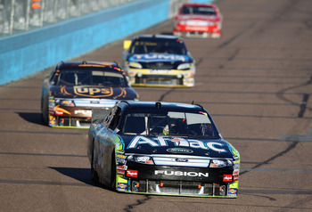 AVONDALE, AZ - NOVEMBER 14:  Carl Edwards, driver of the #99 Aflac Ford, drives during the NASCAR Sprint Cup Series Kobalt Tools 500 at Phoenix International Raceway on November 14, 2010 in Avondale, Arizona.  (Photo by Christian Petersen/Getty Images for