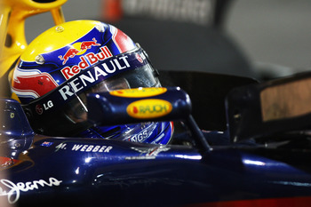 ABU DHABI, UNITED ARAB EMIRATES - NOVEMBER 14:  Mark Webber of Australia and Red Bull Racing drives into parc ferme following the Abu Dhabi Formula One Grand Prix at the Yas Marina Circuit on November 14, 2010 in Abu Dhabi, United Arab Emirates.  (Photo b