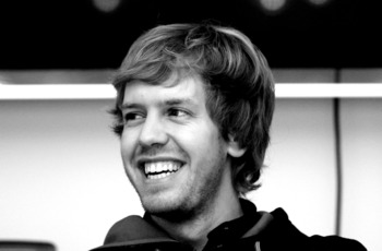 MILTON KEYNES, ENGLAND - NOVEMBER 16:  New Formula 1 World Champion Red Bull racing driver  Sebastian Vettel talking to the media at the teams headquaters in Milton Keynes on November 16, 2010 in Milton Keynes, England.  (Photo by Mark Thompson/Getty Imag
