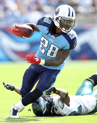 NASHVILLE, TN - OCTOBER 24:  Chris Johnson #28 of the Tennessee Titans runs with the while defended by Asante Samuel #22 of the Philadelphia Eagles at LP Field on October 24, 2010 in Nashville, Tennessee. The Titans won 37-19.  (Photo by Andy Lyons/Getty
