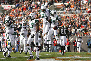 CLEVELAND - NOVEMBER 14:  Wide receiver Jerricho Cotchery #89 of the New York Jets celebrates with Dustin Keller #81 after scoring a touchdown against the Cleveland Browns at Cleveland Browns Stadium on November 14, 2010 in Cleveland, Ohio.  (Photo by Mat