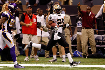 NEW ORLEANS - OCTOBER 06:  Reggie Bush #25 of the New Orleans Saints runs back a punt for a touchdown against the Minnesota Vikings on October 6, 2008 at the Superdome in New Orleans, Louisiana.  Bush tied an NFL record by returning two punts for touchdow