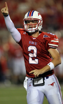DALLAS - SEPTEMBER 24:  Quarterback Kyle Padron #2 of the SMU Mustangs celebrates a touchdown in the third quarter against the TCU Horned Frogs at Gerald J. Ford Stadium on September 24, 2010 in Dallas, Texas.  (Photo by Ronald Martinez/Getty Images)