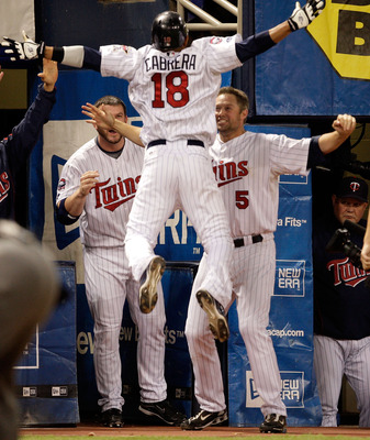 MINNEAPOLIS - OCTOBER 06:  Orlando Cabrera #18 of the Minnesota Twins is congratulated by teammates after hitting a home run against starting pitcher Rick Porcello # 48 of the Detroit Tigers during the 7th inning of the American League Tiebreaker game on