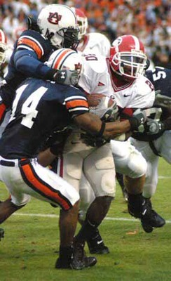 Carlos Rogers 14 makes a tackle against UGA in 2004