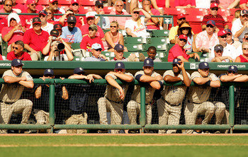ST. LOUIS - OCTOBER 04:  The San Diego Padres bench watch as the game comes to a close in the ninth inning of Game One of the National League Divison Series against the St. Louis Cardinals at Busch Stadium on October 4, 2005 in St. Louis, Missouri.  The C