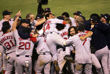 The 2004 Boston Red Sox, the American League Wild-Card team, celebrate the franchise's first title in 86 years