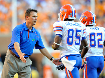 KNOXVILLE, TN - SEPTEMBER 18:  Coach Urban Meyer of the Florida Gators congratulates his players after scoring a touchdown against the Tennessee Volunteers at Neyland Stadium on September 18, 2010 in Knoxville, Tennessee.  (Photo by Grant Halverson/Getty