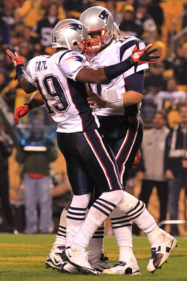 PITTSBURGH - NOVEMBER 14:  Tom Brady #12 of the New England Patriots celebrates his touchdown with team mate Brandon Tate #19 against the Pittsburgh Steelers on November 14, 2010 at Heinz Field in Pittsburgh, Pennsylvania.  (Photo by Chris McGrath/Getty I