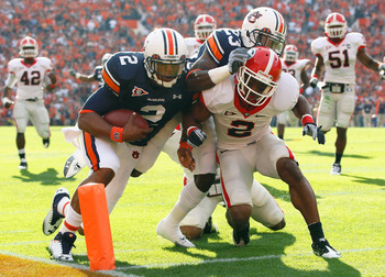 AUBURN, AL - NOVEMBER 13:  Quarterback Cameron Newton #2 of the Auburn Tigers stays in bounds as he scores a touchdown against Brandon Boykin #2 of the Georgia Bulldogs at Jordan-Hare Stadium on November 13, 2010 in Auburn, Alabama.  (Photo by Kevin C. Co