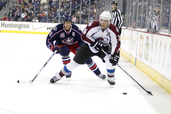COLUMBUS,OH - NOVEMBER 12:  R.J. Umberger #18 of the Columbus Blue Jackets skates after Paul Stastny #26 of the Colorado Avalanche on November 12, 2010 at Nationwide Arena in Columbus, Ohio.  (Photo by John Grieshop/Getty Images)