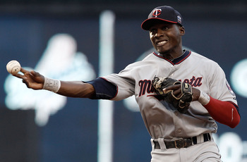 CLEVELAND, OH- APRIL 30: Orlando Hudson #1 of the Minnesota Twins throws to first base during the game against the Cleveland Indians on April 30, 2010 at Progressive Field in Cleveland, Ohio.  (Photo by Jared Wickerham/Getty Images)
