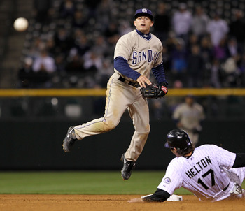 DENVER - APRIL 10:  Second baseman David Eckstein #22 of the San Diego Padres turns a double play on Todd Helton #17 of the Colorado Rockies on a grounder by Troy Tulowitzki to Chase Headley in the 14th inning during MLB action at Coors Field on April 10,