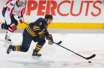 BUFFALO, NY - NOVEMBER 13: Derek Roy #9 of the Buffalo Sabres leads a rush ahead of Eric Fehr #16 of the Washington Capitals at HSBC Arena on November 13, 2010 in Buffalo, New York.  (Photo by Rick Stewart/Getty Images)