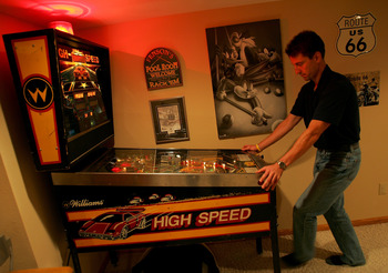 BEMIDJI, MN - SEPTEMBER 28:  Pete Fenson plays pinball in his basement September 28, 2005 in Bemidji, Minnesota. Pete Fenson is a curler and will represent the US at the Olympic games in Torino. (Photo by Matthew Stockman/Getty Images)
