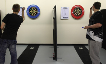 STOCKPORT, ENGLAND - JANUARY 21:  Students step up to the oche at Britain's first Darts Academy at Stockport College on January 21, 2010 in Stockport, England. The new academy is run by former professional darts player Paul McDonagh. One of the student co