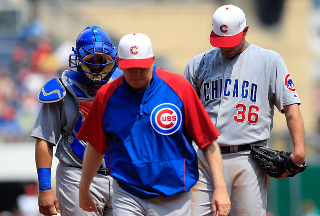 PITTSBURGH - MAY 31:  Pitching coach Larry Rothschild #50 and Geovany Soto #18 of the Chicago Cubs walk away after talking with teammate Randy Wells #36 during the game against the Pittsburgh Pirates on May 31, 2010 at PNC Park in Pittsburgh, Pennsylvania