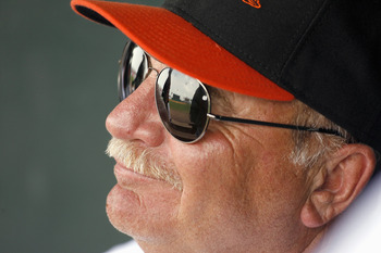 FT. LAUDERDALE, FL - MARCH 2: Pitching Coach Leo Mazzone #54 of the Baltimore Orioles smiles in the dugout against the Florida Marlins at Ft. Lauderdale Stadium during spring training March 2, 2007 in Ft. Lauderdale, Florida. (Photo by Marc Serota/Getty I