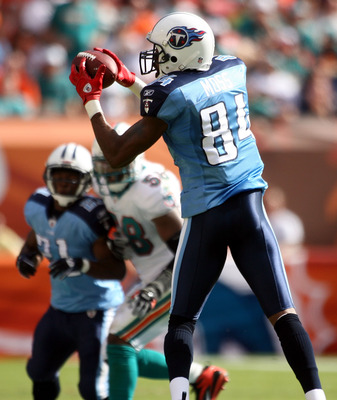 MIAMI - NOVEMBER 14:  Wide receiver Randy Moss #84 of the Tennessee Titans makes a catch against the Miami Dolphins at Sun Life Stadium on November 14, 2010 in Miami, Florida.  (Photo by Marc Serota/Getty Images)