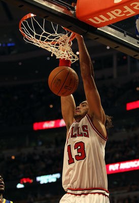 CHICAGO - NOVEMBER 11: Joakim Noah #13 of the Chicago Bulls dunks the ball against the Golden State Warriors at the United Center on November 11, 2010 in Chicago, Illinois. The Bulls defeated the Warriors 120-90. NOTE TO USER: User expressly acknowledges