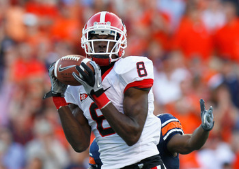 AUBURN, AL - NOVEMBER 13:  A.J. Green #8 of the Georgia Bulldogs pulls in this touchdown reception against Demond Washington #14 of the Auburn Tigers at Jordan-Hare Stadium on November 13, 2010 in Auburn, Alabama.  (Photo by Kevin C. Cox/Getty Images)