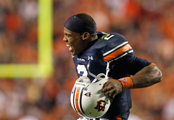 AUBURN, AL - NOVEMBER 13:  Quarterback Cameron Newton #2 of the Auburn Tigers celebrates after an official review showed Newton crossed the end zone after diving for a touchdown against the Georgia Bulldogs at Jordan-Hare Stadium on November 13, 2010 in A