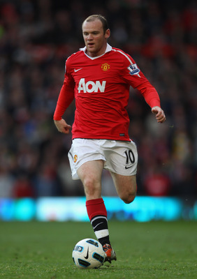 MANCHESTER, ENGLAND - OCTOBER 16:  Wayne Rooney of Manchester United runs with the ball during the Barclays Premier League match between Manchester United and West Bromwich Albion at Old Trafford on October 16, 2010 in Manchester, England.  (Photo by Alex