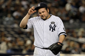 NEW YORK - OCTOBER 19:  Joba Chamberlain #62 of the New York Yankees reacts as he walks back to the dugout at the end of the top of the eighth inning against the Texas Rangers in Game Four of the ALCS during the 2010 MLB Playoffs at Yankee Stadium on Octo