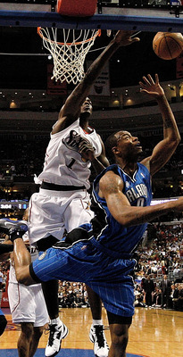 PHILADELPHIA - APRIL 30:  Rashard Lewis #9 of the Orlando Magic lays the ball up under the block of Samuel Dalembert #1 of the Philadelphia 76ers during Game Six of the Eastern Conference Quarterfinals at Wachovia Center on April 30, 2009 in Philadelphia,