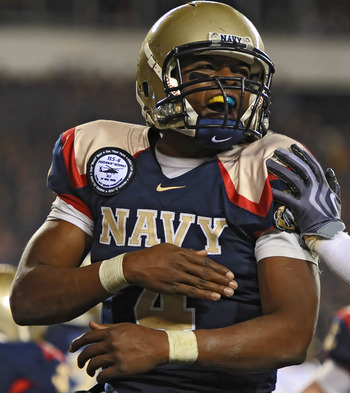 PHILADELPHIA - DECEMBER 12: Quarterback Ricky Dobbs #4 of the Navy Midshipmen celebrates a touchdown during the game against the Army Black Knights on December 12, 2009 at Lincoln Financial Field in Philadelphia, Pennsylvania. Navy won 17-3. (Photo by Dre