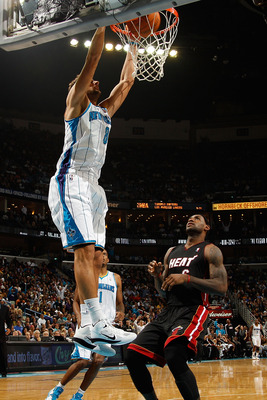 NEW ORLEANS - NOVEMBER 05:  Marco Belinelli #8 of the New Orleans Hornets dunks the ball during the game against the Miami Heat at the New Orleans Arena on November 5, 2010 in New Orleans, Louisiana.  NOTE TO USER: User expressly acknowledges and agrees t