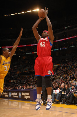 LOS ANGELES - FEBRUARY 26:  Elton Brand #42 of the Philadelphia 76ers shoots against Ron Artest #37 of the Los Angeles Lakers at Staples Center on February 26, 2010 in Los Angeles, California. NOTE TO USER: User expressly acknowledges and agrees that, by