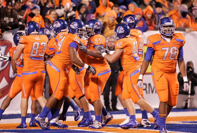 BOISE, ID - NOVEMBER 19:  The Boise State Broncos celebrate after a touchdown against the Fresno State Bulldogs at Bronco Stadium on November 19, 2010 in Boise, Idaho.  (Photo by Otto Kitsinger III/Getty Images)
