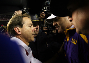 TUSCALOOSA, AL - NOVEMBER 03:  Head coach Les Miles of the LSU Tigers is congratulated by head coach Nick Saban of the Alabama Crimson Tide at Bryant-Denny Stadium on November 3, 2007 in Tuscaloosa, Alabama. LSU defeated Alabama 41-34.  (Photo by Doug Ben