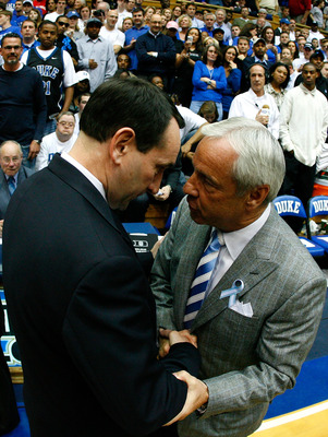 DURHAM, NC - MARCH 8:  Head coach Mike Krzyzewski (L) of the Duke Blue Devils shakes hands with head coach Roy Williams of the North Carolina Tar Heels before their game at Cameron Indoor Stadium March 8, 2008 in Durham, North Carolina.  (Photo by Kevin C