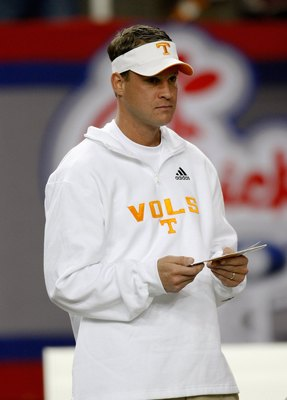 ATLANTA - DECEMBER 31:  Tennessee Volunteers head coach Lane Kiffin watches warmups on the field before the Chick-Fil-A Bowl against the Virginia Tech Hokies at the Georgia Dome on December 31, 2009 in Atlanta, Georgia.  Virginia Tech beat Tennessee 37-14