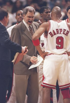 4 Jun 1997:  Coach Phil Jackson speaks with guards Ron Harper and Toni Kukoc of the Chicago Bulls during a playoff game against the Utah Jazz at the United Center in Chicago, Illinois.  The Bulls won the game 97-85. Mandatory Credit: Jonathan Daniel  /All