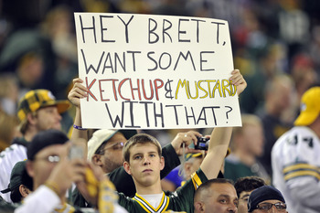 GREEN BAY, WI - OCTOBER 24:  Fans hold up signs as Brett Favre #4 of the Minnesota Vikings takes the field for warmups against the Green Bay Packers at Lambeau Field on October 24, 2010 in Green Bay, Wisconsin. (Jim Prisching/Getty Images)