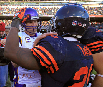 CHICAGO - NOVEMBER 14: Brett Favre #4 of the Minnesota Vikings talks with Chester Taylor #29 of the Chicago Bears following a game at Soldier Field on November 14, 2010 in Chicago, Illinois. The Bears defeated the Vikings 27-13. (Photo by Jonathan Daniel/