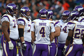 CHICAGO - NOVEMBER 14: Brett Favre #4 of the Minnesota Vikings talks to his offensive teammates in the huddle during a game against the Chicago Bears at Soldier Field on November 14, 2010 in Chicago, Illinois. The Bears defeated the Vikings 27-13. (Photo