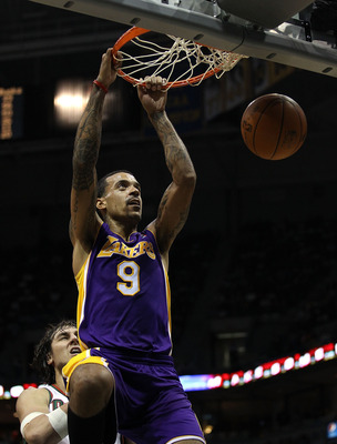 MILWAUKEE - NOVEMBER 16: Matt Barnes #9 of the Los Angeles Lakers dunks the ball over Andrew Bogut #6 of the Milwaukee Bucks at the Bradley Center on November 16, 2010 in Milwaukee, Wisconsin. The Lakers defeated the Bucks 118-107. NOTE TO USER: User expr